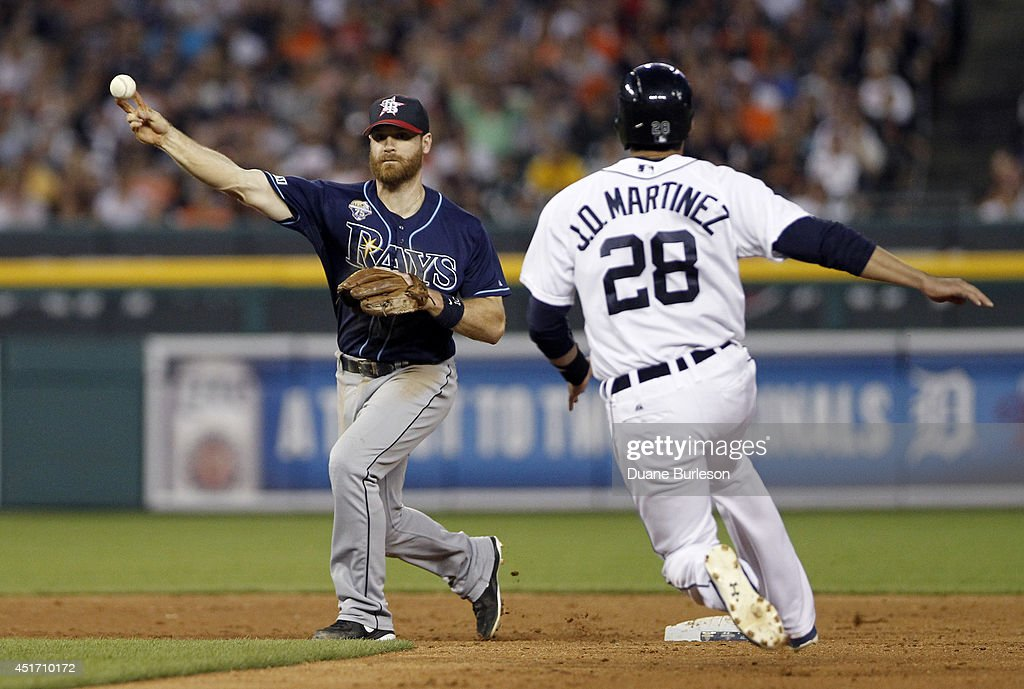 Second baseman <a gi-track='captionPersonalityLinkClicked' href=/galleries/search?phrase=Logan+Forsythe&family=editorial&specificpeople=4412508 ng-click='$event.stopPropagation()'>Logan Forsythe</a> #10 of the Tampa Bay Rays turns the ball after getting a force out on <a gi-track='captionPersonalityLinkClicked' href=/galleries/search?phrase=J.D.+Martinez&family=editorial&specificpeople=7520024 ng-click='$event.stopPropagation()'>J.D. Martinez</a> #28 of the Detroit Tigers at second base during the sixth inning at Comerica Park on July 4, 2014 in Detroit, Michigan. Torii Hunter hit into the play and was out at first base.