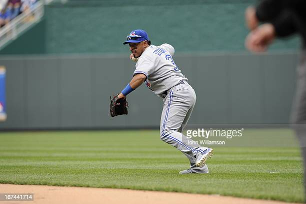 Second baseman Macier Izturis of the Toronto Blue Jays fields his position as he throws to first base after catching a ground ball in the game...