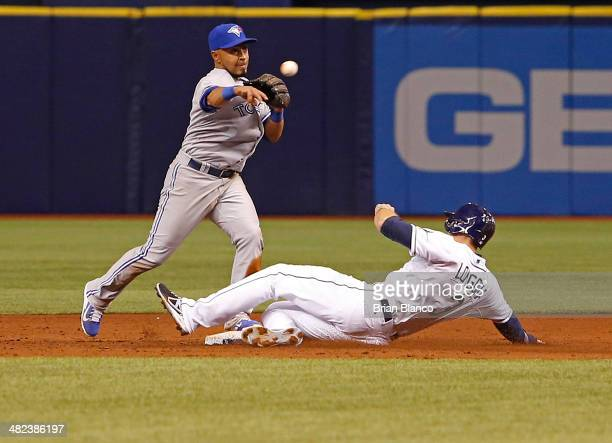 Second baseman Maicer Izturis of the Toronto Blue Jays gets the out on Evan Longoria of the Tampa Bay Rays at second base then throws to first for...
