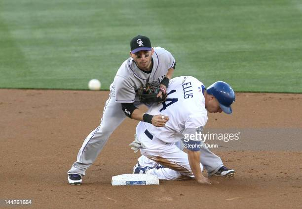 Second baseman Marco Scutaro of the Colorado Rockies throws to first to complete a double play ending the first inning after forcing out Mark Elliis...