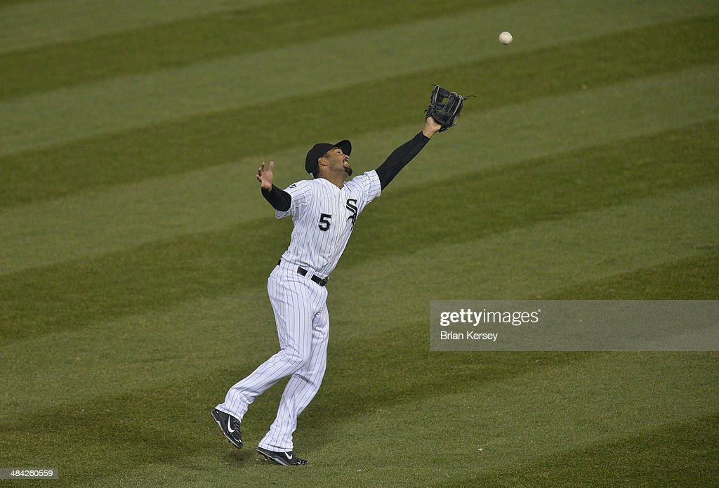 Second baseman <a gi-track='captionPersonalityLinkClicked' href=/galleries/search?phrase=Marcus+Semien&family=editorial&specificpeople=10527396 ng-click='$event.stopPropagation()'>Marcus Semien</a> #5 of the Chicago White Sox reaches for a fly ball hit by Mike Aviles #4 of the Cleveland Indians during the second inning at U.S. Cellular Field on April 11, 2014 in Chicago, Illinois. The ball dropped in for a single.