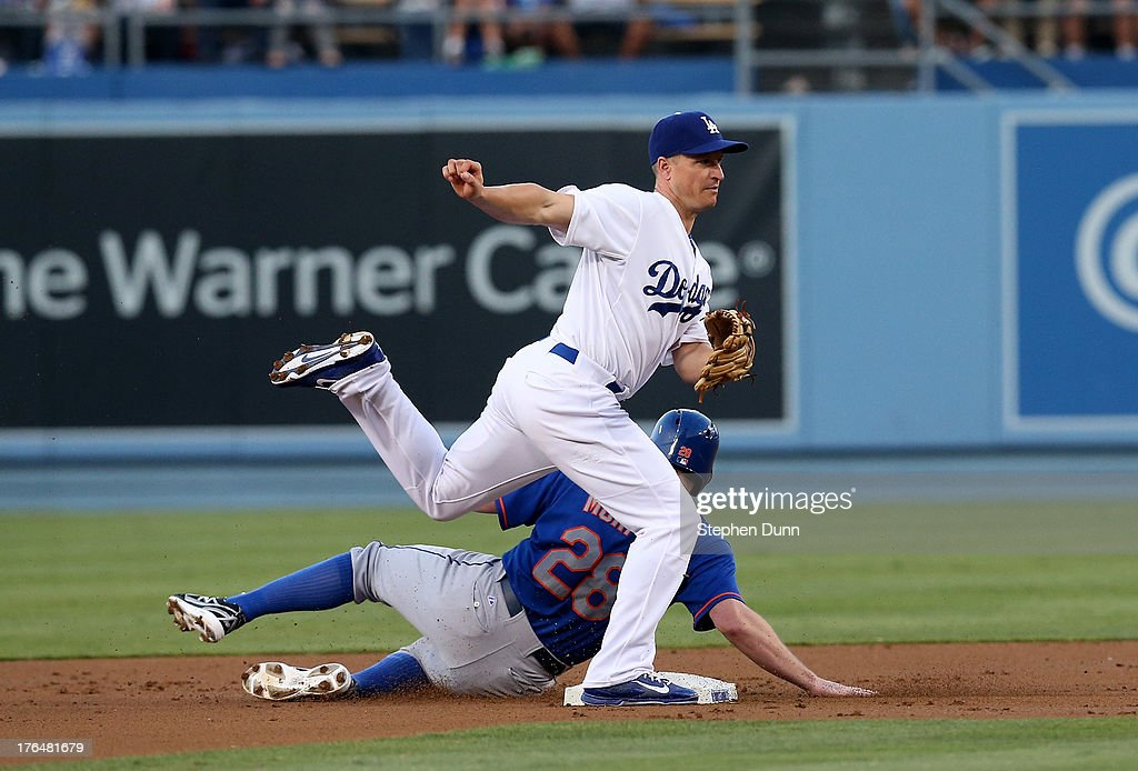 Second baseman <a gi-track='captionPersonalityLinkClicked' href=/galleries/search?phrase=Mark+Ellis+-+Baseball+Player&family=editorial&specificpeople=213759 ng-click='$event.stopPropagation()'>Mark Ellis</a> #14 of the Los Angeles Dodgers watches his throw to first after forcing out Daniel Murphy #28 of the New York Mets to complete a double play ending the Mets' first inning at Dodger Stadium on August 13, 2013 in Los Angeles, California.