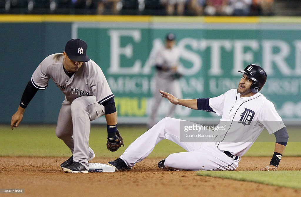 Second baseman Martin Prado #14 of the New York Yankees beats J.D. Martinez #28 of the Detroit Tigers to the bag to get a force out during the sixth inning at Comerica Park on August 27, 2014 in Detroit, Michigan. The Yankees defeated the Tigers 8-4.