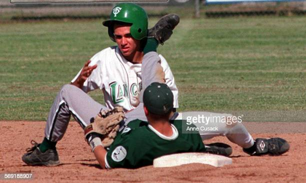 Second baseman Matt Pesso tangles with Eleo Cuadra in the fifth inning of play of TOHS vs Royal HS at TO