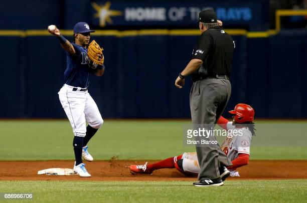 Second baseman Michael Martinez of the Tampa Bay Rays gets the force out at second base on Cameron Maybin of the Los Angeles Angels and turns a...