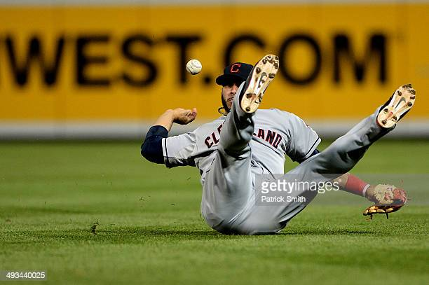 Second baseman Mike Aviles of the Cleveland Indians cannot make a play on a hit by Adam Jones of the Baltimore Orioles in the fifth inning at Oriole...