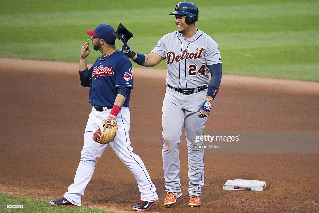 Second baseman <a gi-track='captionPersonalityLinkClicked' href=/galleries/search?phrase=Mike+Aviles&family=editorial&specificpeople=4944765 ng-click='$event.stopPropagation()'>Mike Aviles</a> #4 of the Cleveland Indians gets a tap on the head from <a gi-track='captionPersonalityLinkClicked' href=/galleries/search?phrase=Miguel+Cabrera&family=editorial&specificpeople=202141 ng-click='$event.stopPropagation()'>Miguel Cabrera</a> #24 of the Detroit Tigers after Cabrera hit a double during the fourth inning at Progressive Field on May 20, 2014 in Cleveland, Ohio.