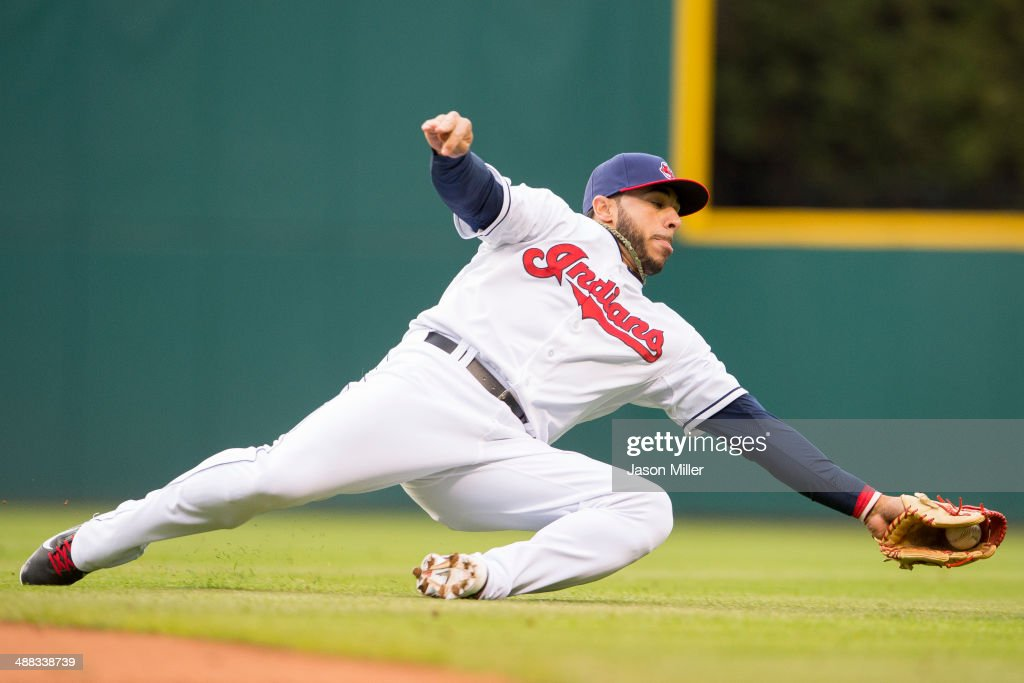 Second baseman <a gi-track='captionPersonalityLinkClicked' href=/galleries/search?phrase=Mike+Aviles&family=editorial&specificpeople=4944765 ng-click='$event.stopPropagation()'>Mike Aviles</a> #4 of the Cleveland Indians snags a ground ball off the bat of Pedro Florimon (not pictured) of the Minnesota Twins during the third inning at Progressive Field on May 5, 2014 in Cleveland, Ohio.