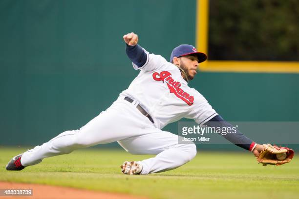 Second baseman Mike Aviles of the Cleveland Indians snags a ground ball off the bat of Pedro Florimon of the Minnesota Twins during the third inning...