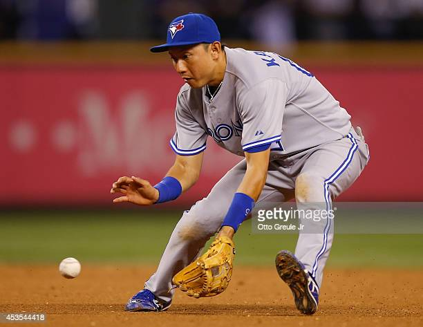 Second baseman Munenori Kawasaki of the Toronto Blue Jays fields a grounder off the bat of Robinson Cano of the Seattle Mariners in the eighth inning...