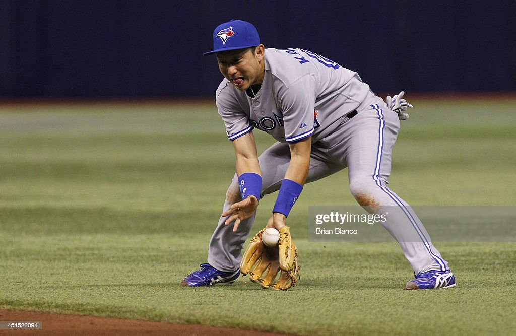 Second baseman <a gi-track='captionPersonalityLinkClicked' href=/galleries/search?phrase=Munenori+Kawasaki&family=editorial&specificpeople=690355 ng-click='$event.stopPropagation()'>Munenori Kawasaki</a> #66 of the Toronto Blue Jays fields a ground ball off the bat of Ben Zobrist of the Tampa Bay Rays during the fifth inning of a game on September 2, 2014 at Tropicana Field in St. Petersburg, Florida.
