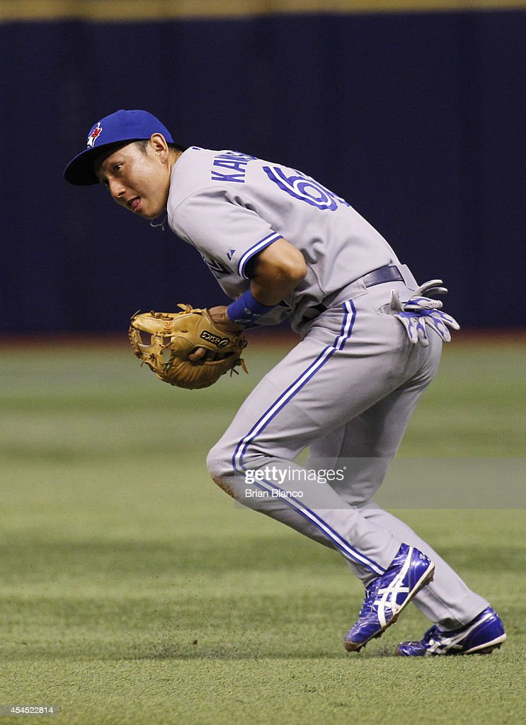Second baseman <a gi-track='captionPersonalityLinkClicked' href=/galleries/search?phrase=Munenori+Kawasaki&family=editorial&specificpeople=690355 ng-click='$event.stopPropagation()'>Munenori Kawasaki</a> #66 of the Toronto Blue Jays fields the ground ball by Ben Zobrist #18 of the Tampa Bay Rays during the fifth inning of a game on September 2, 2014 at Tropicana Field in St. Petersburg, Florida.