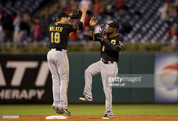 Second baseman Neil Walker and left fielder Starling Marte of the Pittsburgh Pirates react after defeating the Philadelphia Phillies on September 8...