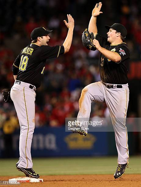 Second baseman Neil Walker and right fielder Travis Snider of the Pittsburgh Pirates celebrate after the game against the Los Angeles Angels of...