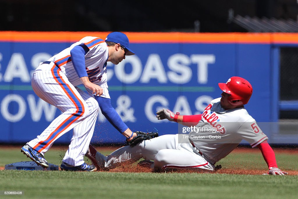Second baseman Neil Walker New York Mets tags out Carlos Ruiz Philadelphia Phillies as he tries to steal second base during the New York Mets Vs...