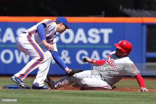 Second baseman Neil Walker New York Mets tags out Carlos Ruiz Philadelphia Phillies as he tries to steal second base during the New York Mets Vs...