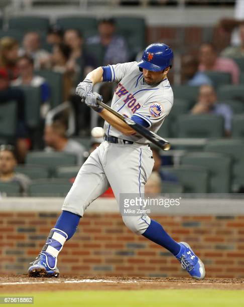 Second baseman Neil Walker of the New York Mets hits an RBI single in the fourth inning during the game against the Atlanta Braves at SunTrust Park...