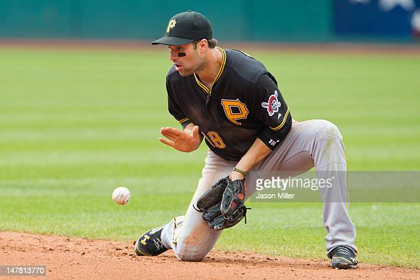 Second baseman Neil Walker of the Pittsburgh Pirates files a ground ball during the fourth inning against the Cleveland Indians at Progressive Field...
