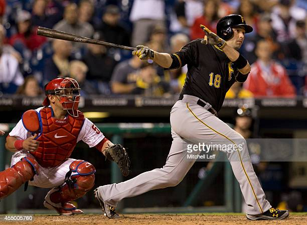 Second baseman Neil Walker of the Pittsburgh Pirates hits an RBI single in the top of the eighth inning against the Philadelphia Phillies on...