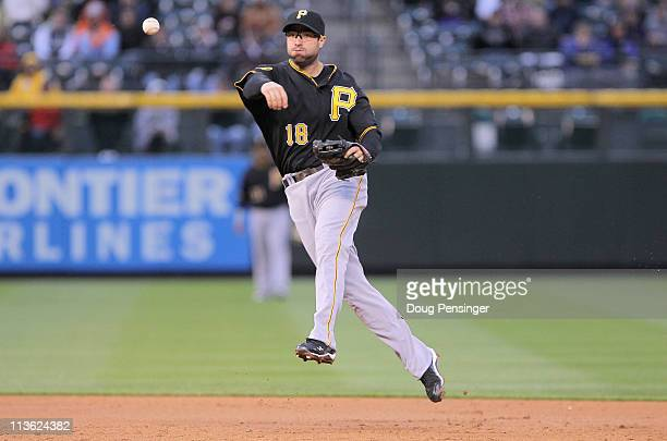 Second baseman Neil Walker of the Pittsburgh Pirates throws out a runner against the Colorado Rockies at Coors Field on April 29 2011 in Denver...