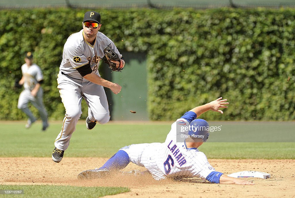Second baseman Neil Walker #18 of the Pittsburgh Pirates turns a double play as Bryan LaHair #6 of the Chicago Cubs slides into second base during the third inning at Wrigley Field on September 4, 2011 in Chicago, Illinois.