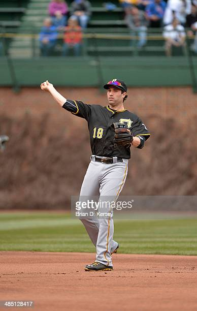 Second baseman Neil Walker of the Pittsburgh Pirates warms up before the first inning against the Chicago Cubs at Wrigley Field on April 10 2014 in...