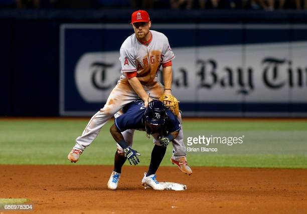 Second baseman Nolan Fontana of the Los Angeles Angels leaps over Michael Martinez of the Tampa Bay Rays after getting the force out at second base...