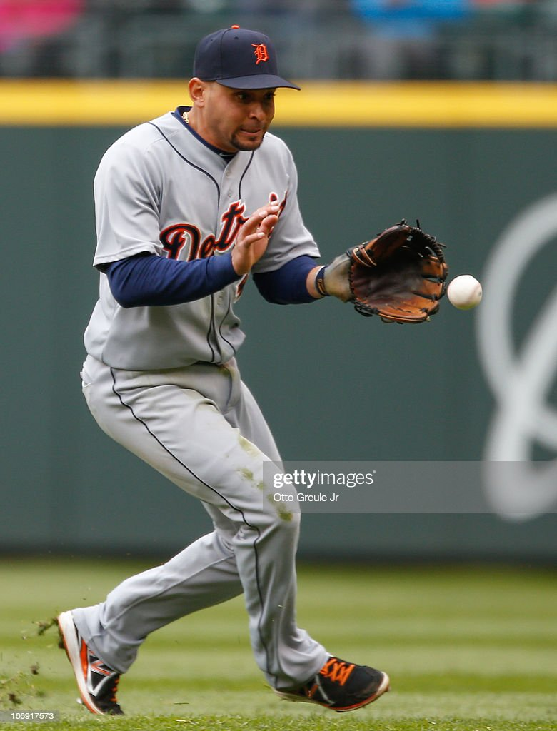 Second baseman <a gi-track='captionPersonalityLinkClicked' href=/galleries/search?phrase=Omar+Infante&family=editorial&specificpeople=203255 ng-click='$event.stopPropagation()'>Omar Infante</a> #4 of the Detroit Tigers fields a single by Robert Andino of the Seattle Mariners in the fifth inning at Safeco Field on April 18, 2013 in Seattle, Washington. The Mariners defeated the Tigers 2-0.