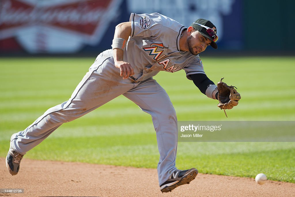 Second baseman <a gi-track='captionPersonalityLinkClicked' href=/galleries/search?phrase=Omar+Infante&family=editorial&specificpeople=203255 ng-click='$event.stopPropagation()'>Omar Infante</a> #12 of the Miami Marlins can't get to a ground ball hit during the fifth inning against the Cleveland Indians at Progressive Field on May 19, 2012 in Cleveland, Ohio.