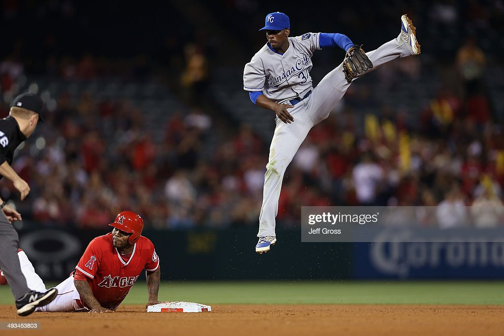 Second baseman <a gi-track='captionPersonalityLinkClicked' href=/galleries/search?phrase=Pedro+Ciriaco&family=editorial&specificpeople=5718591 ng-click='$event.stopPropagation()'>Pedro Ciriaco</a> #37 of the Kansas City Royals leaps for a ball that was overthrown from the outfield in the seventh inning, as <a gi-track='captionPersonalityLinkClicked' href=/galleries/search?phrase=Howie+Kendrick&family=editorial&specificpeople=628938 ng-click='$event.stopPropagation()'>Howie Kendrick</a> #47 of the Los Angeles Angels of Anaheim looks on from second base at Angel Stadium of Anaheim on May 23, 2014 in Anaheim, California. The Angels defeated the Royals 6-1.