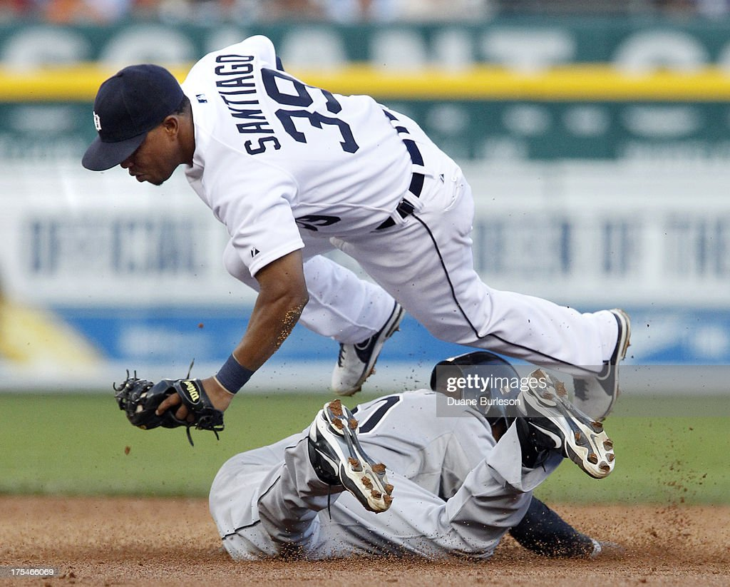 Second baseman Ramon Santiago #39 of the Detroit Tigers is upended in a failed attempt at tagging out Alejandro De Aza #30 of the Chicago White Sox stealing second base in the third inning at Comerica Park on August 3, 2013 in Detroit, Michigan.