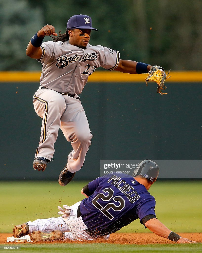 Second baseman Rickie Weeks #23 of the Milwaukee Brewers avoids a sliding Jordan Pacheco #22 of the Colorado Rockies as he turns a double play to end the first inning at Coors Field on August 14, 2012 in Denver, Colorado.
