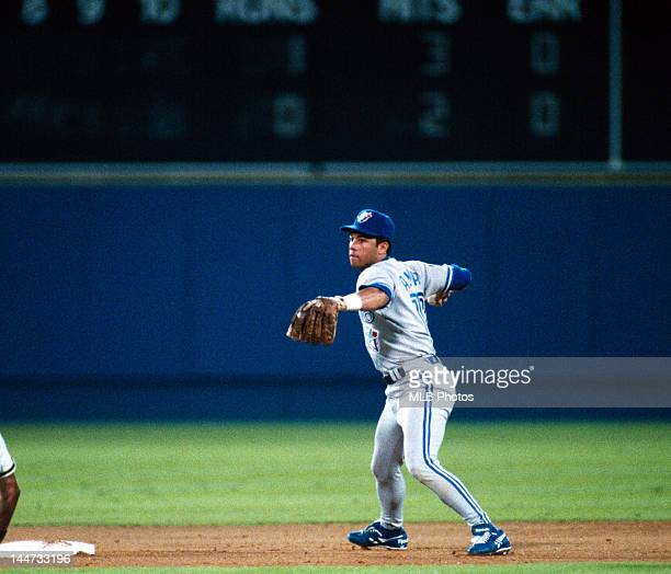 Second Baseman Roberto Alomar of the Toronto Blue Jays looks an Atlanta Braves runner back to third during Game One of the 1992 World Series at...