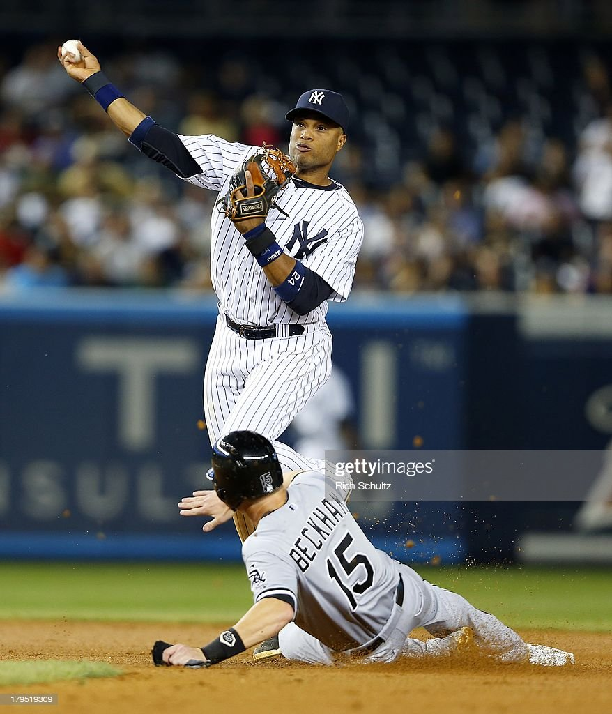 Second baseman Robinson Cano #24 of the New York Yankees gets Gordon Beckham #15 of the Chicago White Sox but Alexei Ramirez #10 beats the throw to first during the eighth inning in a MLB baseball game at Yankee Stadium on September 4, 2013 in the Bronx borough of New York City. The Yankees won 6-5.