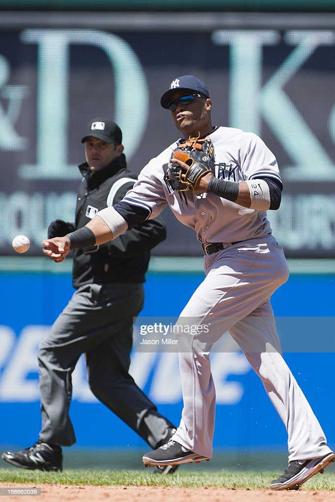 Second baseman <a gi-track='captionPersonalityLinkClicked' href=/galleries/search?phrase=Robinson+Cano&family=editorial&specificpeople=538362 ng-click='$event.stopPropagation()'>Robinson Cano</a> #24 of the New York Yankees throws out Nick Swisher #33 of the Cleveland Indians during the sixth inning during the first game of a doubleheader at Progressive Field on May 13, 2013 in Cleveland, Ohio.