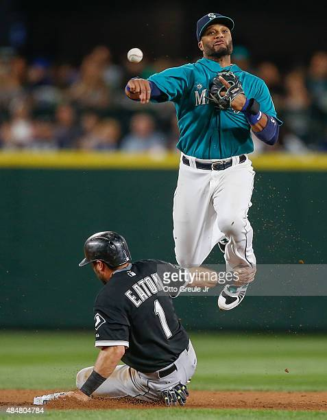 Second baseman Robinson Cano of the Seattle Mariners tries to turn a double play over Adam Eaton of the Chicago White Sox in the fifth inning at...