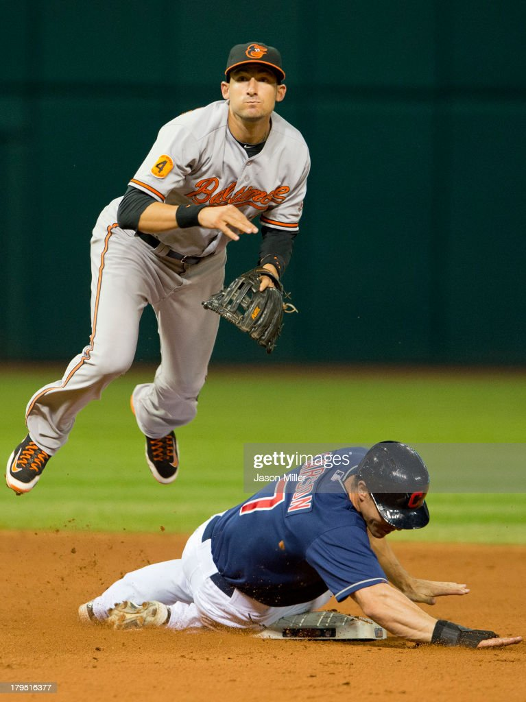 Second baseman <a gi-track='captionPersonalityLinkClicked' href=/galleries/search?phrase=Ryan+Flaherty&family=editorial&specificpeople=4412528 ng-click='$event.stopPropagation()'>Ryan Flaherty</a> #3 of the Baltimore Orioles jumps over Matt Carson #7 of the Cleveland Indians after throwing to first for the double play during the ninth inning at Progressive Field on September 4, 2013 in Cleveland, Ohio.