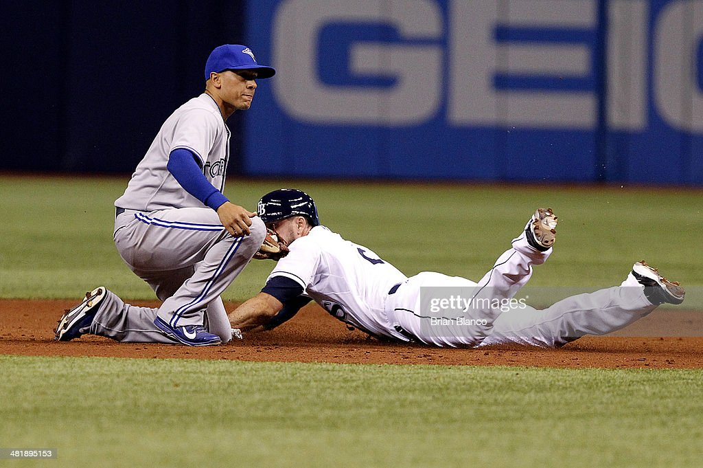 Second baseman Ryan Goins #17 of the Toronto Blue Jays catches Matt Joyce #20 of the Tampa Bay Rays attempting to steal second base during the first inning of a game on April 1, 2014 at Tropicana Field in St. Petersburg, Florida.