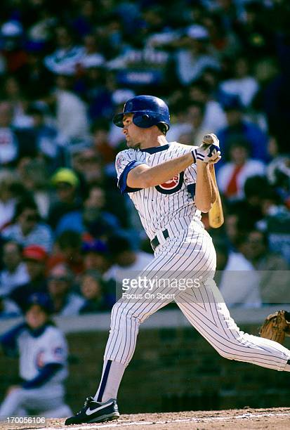 Second baseman Ryne Sandberg of the Chicago Cubs bats during an MLB baseball game circa 1990 at Wrigley Field in Chicago Illinois Sandberg played for...