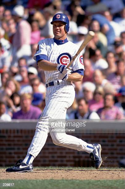 Second Baseman Ryne Sandberg of the Chicago Cubs makes contact with a pitch during a game against the San Francisco Giants at Wrigley Field on May 20...