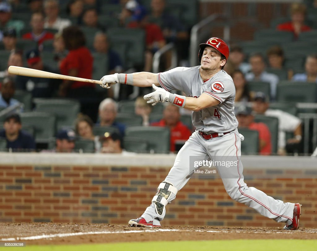 Second baseman Scooter Gennett #4 of the Cincinnati Reds strikes out in the seventh inning during the game against the Atlanta Braves at SunTrust Park on August 18, 2017 in Atlanta, Georgia.