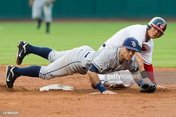 Second baseman Sean Rodriguez of the Tampa Bay Rays and ShinSoo Choo of the Cleveland Indians watch to see the throw to first during the fourth...
