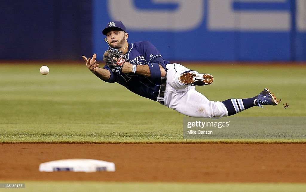 Second baseman Sean Rodriguez #1 of the Tampa Bay Rays makes a throw to second base after fielding a hit by Jackie Bradley Jr. #25 of the Boston Red Sox during the second inning of a baseball game at Tropicana Field on May 23, 2014 in St. Petersburg, Florida.