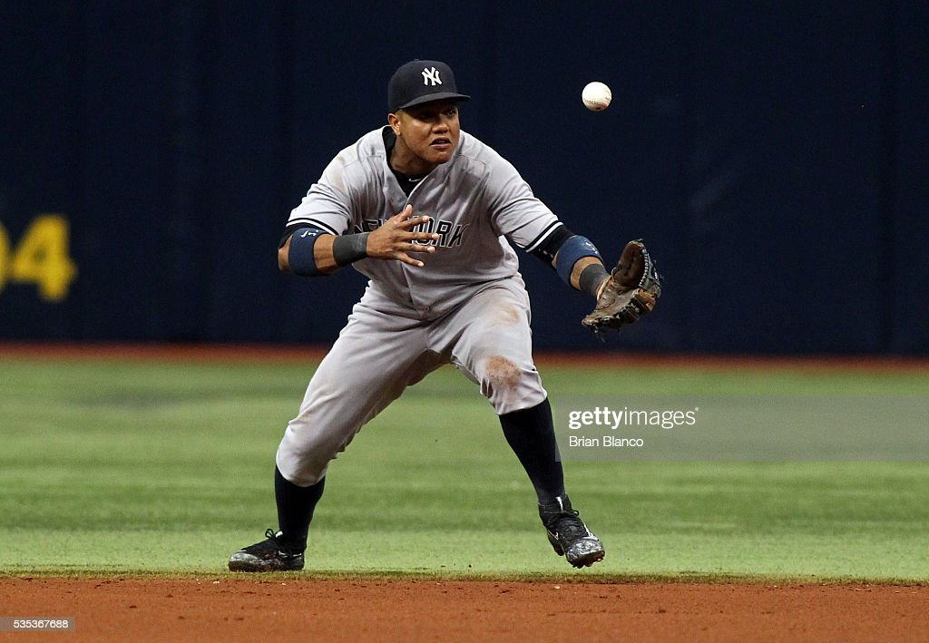 Second baseman <a gi-track='captionPersonalityLinkClicked' href=/galleries/search?phrase=Starlin+Castro&family=editorial&specificpeople=5970945 ng-click='$event.stopPropagation()'>Starlin Castro</a> #14 of the New York Yankees allows Curt Casali of the Tampa Bay Rays to reach first base on an error during the fifth inning of a game on May 29, 2016 at Tropicana Field in St. Petersburg, Florida.