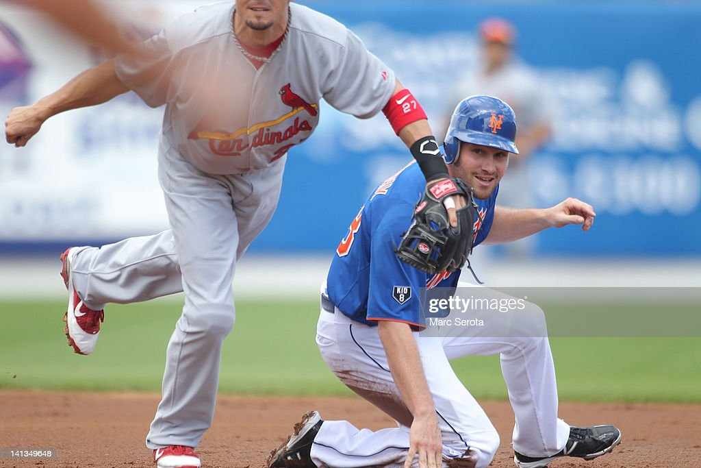 Second baseman Tyler Greene #27 of the St. Louis Cardinals turns a double play against Daniel Murphy of #28 of the New York Mets at Digital Domain Park on March 13, 2012 in Port St. Lucie, Florida.
