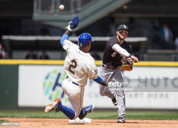 Second baseman Yolmer Sanchez of the Chicago White Sox turns a double play after forcing out Jean Segura of the Seattle Mariners at second base on a...