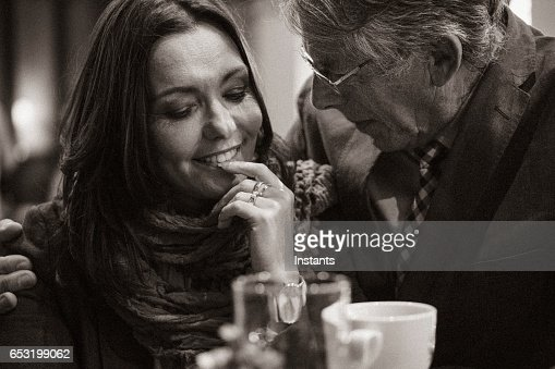 A second chance... First romantic evening in a cafe for a mature couple after some years of solitude. The woman is acting in shyer manner than the man. : Stock Photo