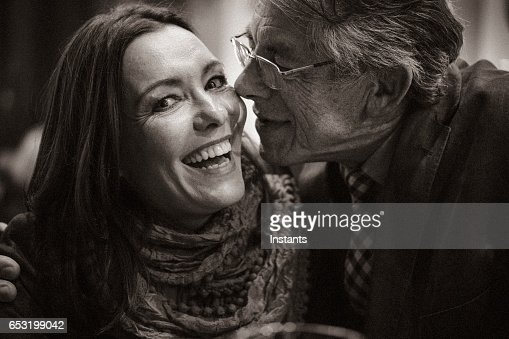 A second chance... Romantic evening in a cafe for a mature couple falling in love after some years of solitude. : Stock-Foto