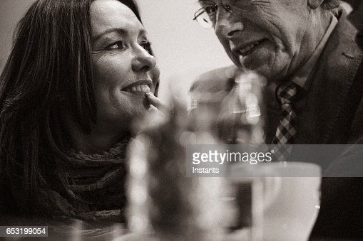 A second chance... Romantic evening in a cafe for a mature couple falling in love after some years of solitude. : Stockfoto