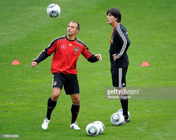 Second coach HansDieter Flick and head coach Joachim Loew attend the Germany training session at Bruchweg stadium on October 5 2011 in Frankfurt am...